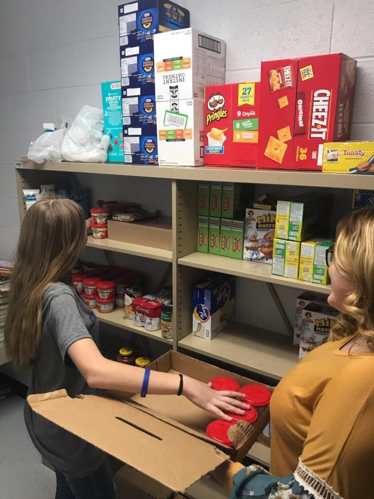 Students stocking school pantry