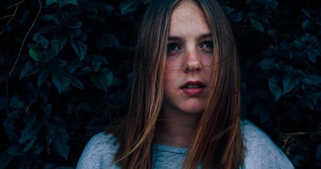 Teen girl with faraway look