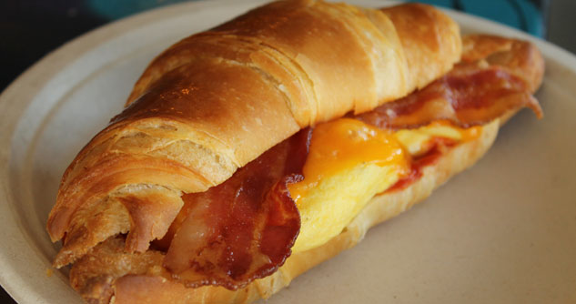 Homemade croissant with bacon, eggs and cheese